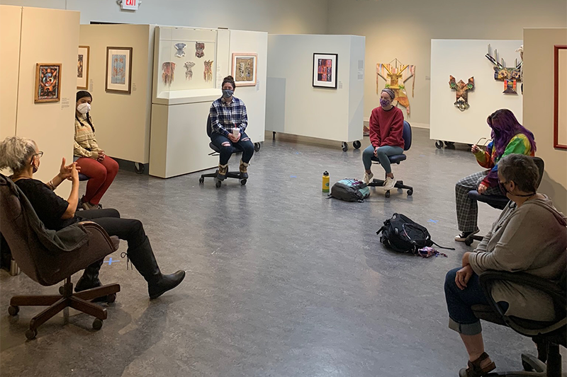 A group talking inside of the Weems Art Gallery