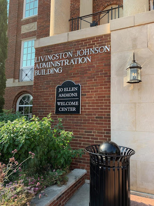 """Building with the text """"Livingston Johnson Administration Building. Jo Ellen Ammons. Welcome Center""""."""