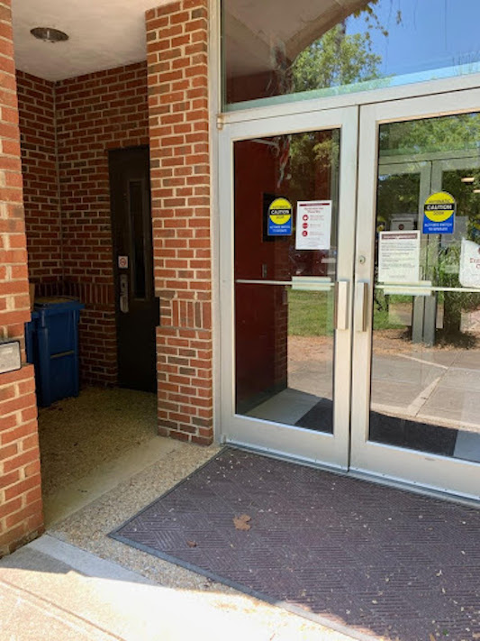 Entrance to Johnson hall with a handicap door button on the left.