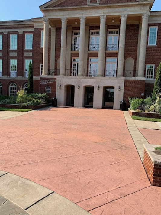 Johnson Hall entrance with a large crosswalk in front.