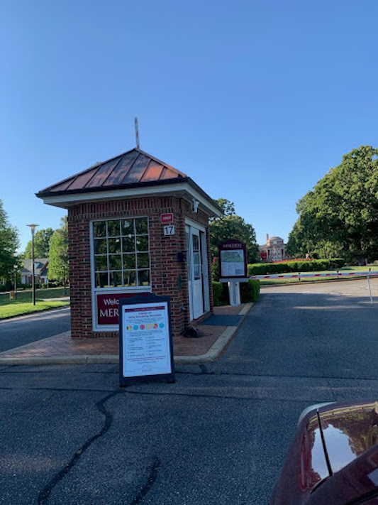 A guard house at the entrance to the campus circle.